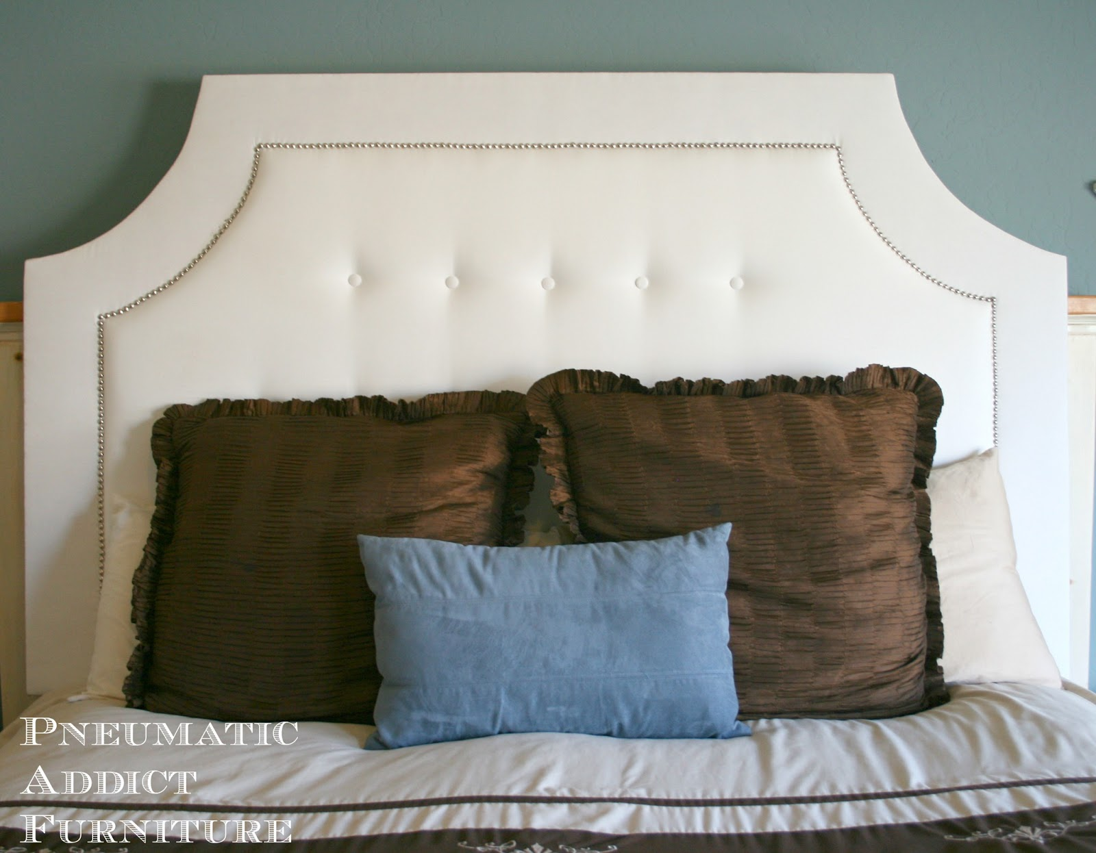 Remodelaholic   DIY Tufted Upholstered Headboard Tutorial build a diy tufted headboard with nailhead trim