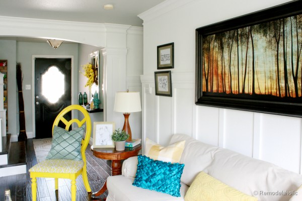 Living Room Remodel with yellow accents wood floors and built-in bookcases and columns with arches-25