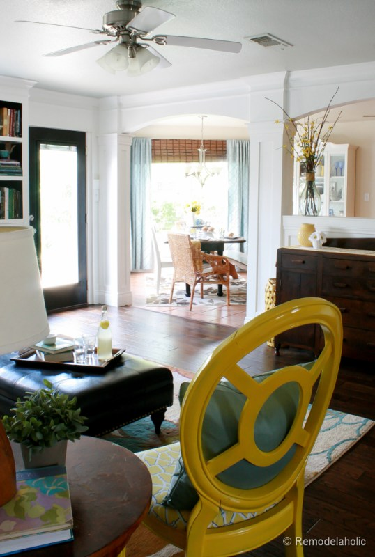 Living Room Remodel with yellow accents wood floors and built-in bookcases and columns with arches-34