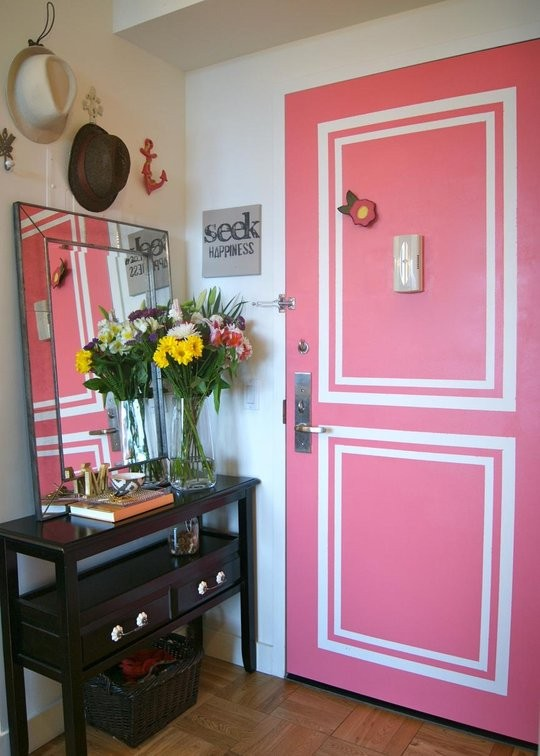 Faux painted moldings on a pink door