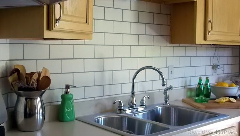 faux painted subway tile kitchen backsplash sink