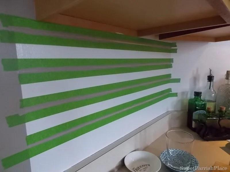 taping painted subway tile backsplash