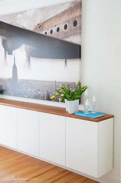 modern dining room with large art and floating sideboard