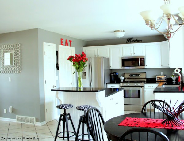 remodeled kitchen with island and barstools and inexpensive light fixtures
