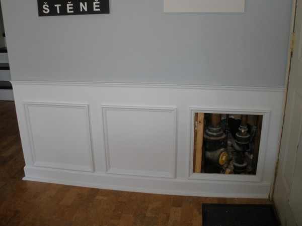 hide plumbing access with wainscoting, The Modern Parsonage on Remodelaholic