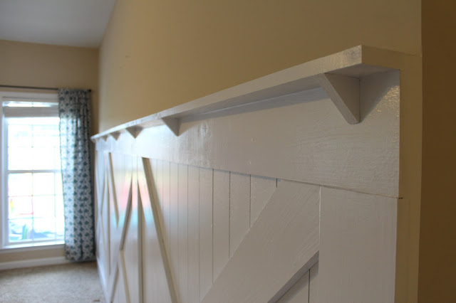 install reinforced ledge to top the barn door inspired wainscoting wall treatment