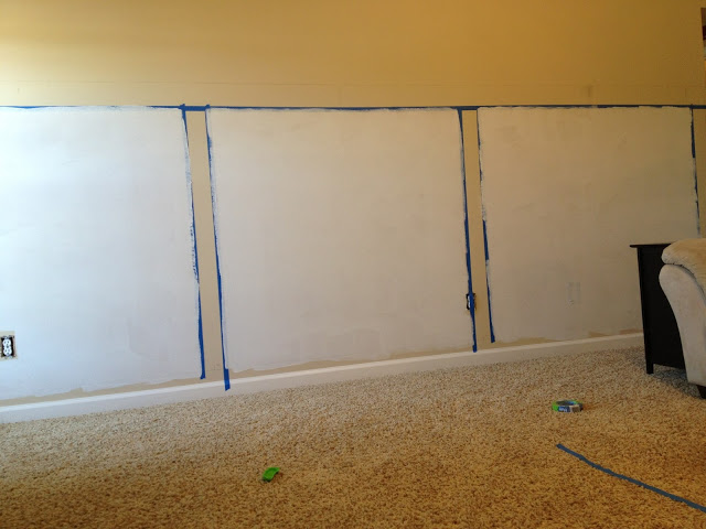 paint the wall behind barn door wainscoting wall treatment