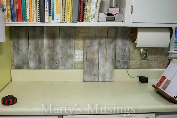Use Primer To Adjust The Color Of Reclaimed Wood For Kitchen Backsplash