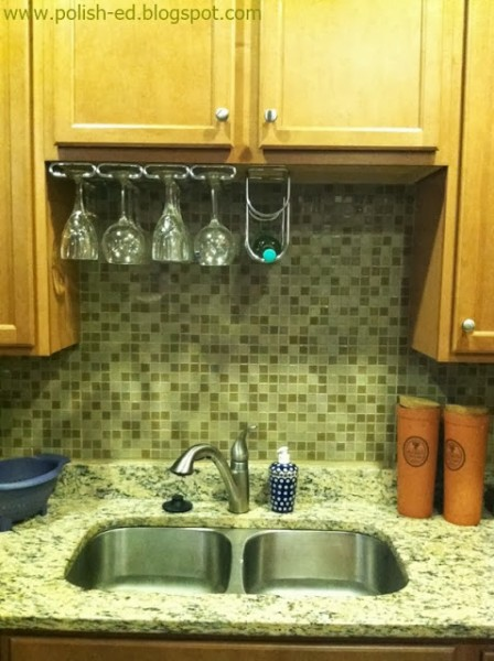 Featured on Remodelaholic: hang wine glasses and a wine rack in the cabinet hole above the sink, Polish-ed