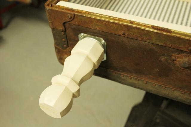 add leg brackets for antique suitcase bookshelf makeover, featured on Remodelaholic.com