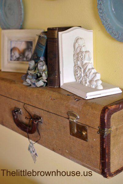 old suitcase turned shelf, The Little Brown House via Remodelaholic.com