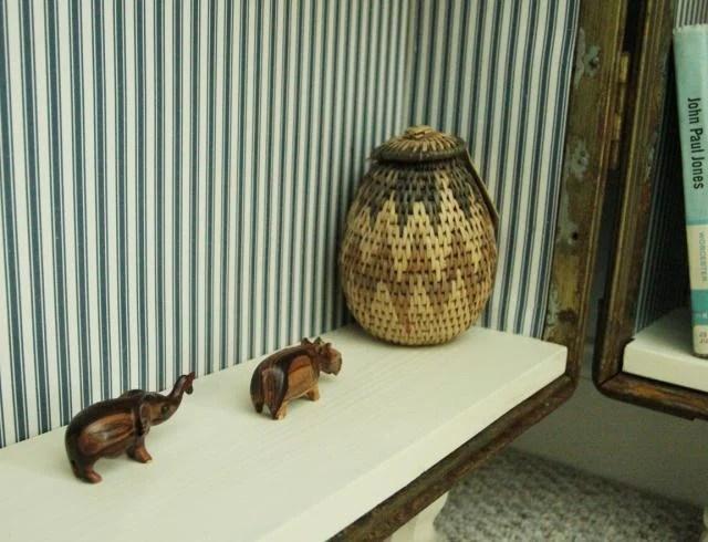 travel momentos details of antique trunk bookshelf, featured on Remodelaholic.com