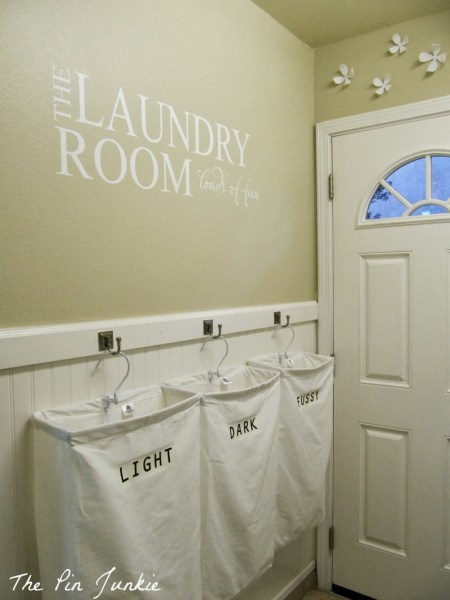 Laundry Room Makeover with Personalized Hanging Laundry Bags, The Pin Junkie featured on Remodelaholic.com
