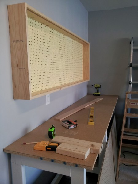 base of pegboard wall-mounted tool organizing cabinet, featured on Remodelaholic.com