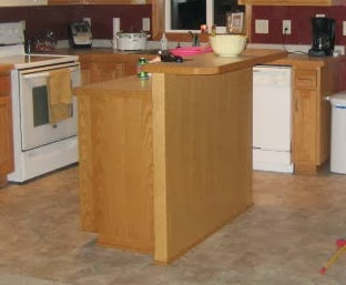 basic builder kitchen island before the makeover, featured on Remodelaholic
