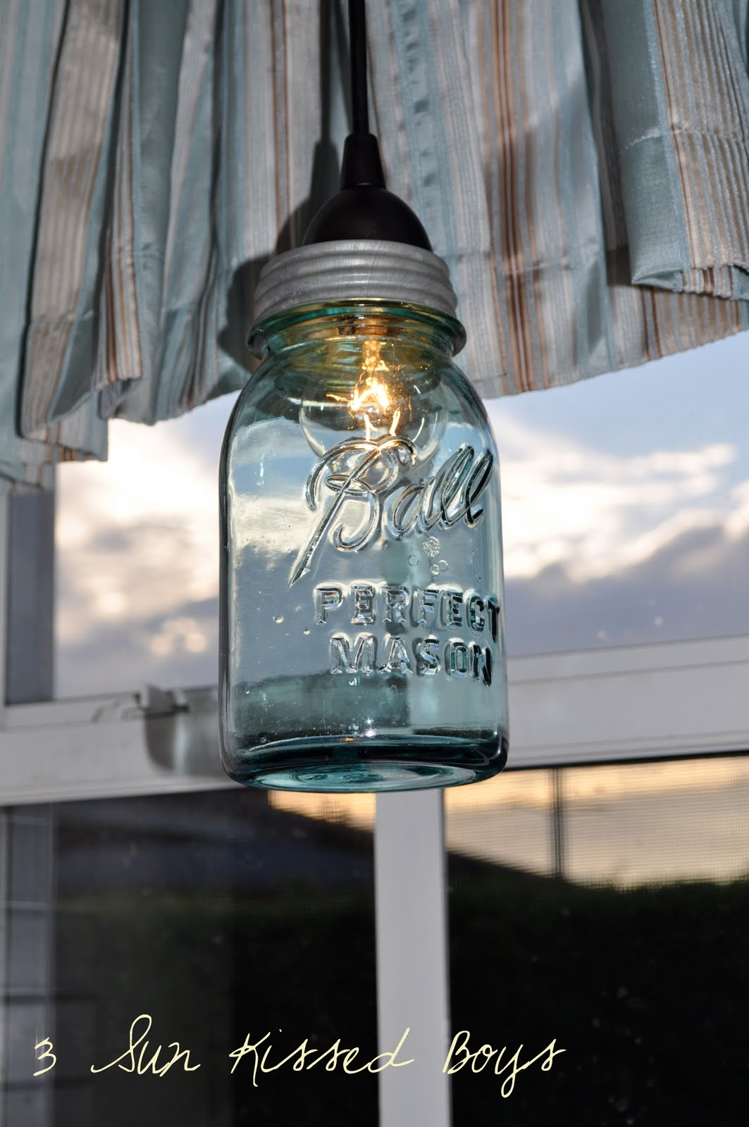 Remodelaholic 14 great diy pendant lights and link party blue tinted mason jar pendant light diy tutorial 3 sunkissed boys featured on remodelaholic aloadofball Image collections