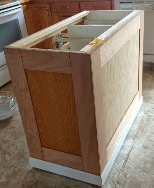 board and batten on a kitchen island makeover, featured on Remodelaholic