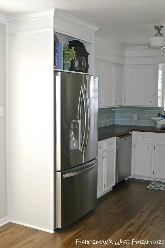 fridge enclosure - vinyl plank flooring - white cabinets - kitchen makeover, Fisherman's Wife Furniture featured on Remodelaholic.com