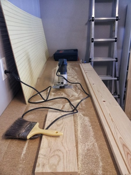 groove in pine board to allow tool cabinet doors to slide, featured on Remodelaholic.com