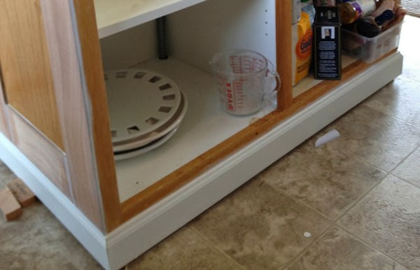 install baseboard molding on a kitchen island, featured on Remodelaholic