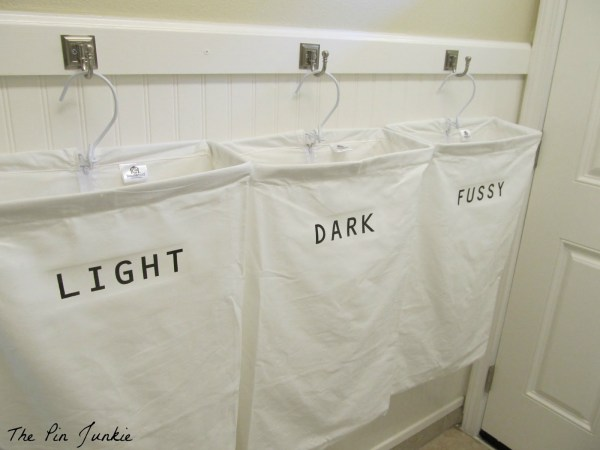laundry room with personalized hanging laundry bags, The Pin Junkie featured on Remodelaholic.com