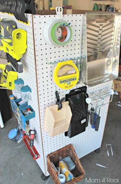 portable garage tool organizer using pegboard, Mom4Real via Remodelaholic