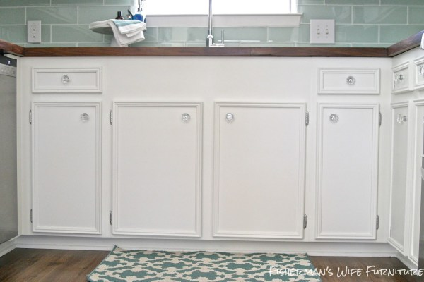 undermount sink front with white cabinets and glass knobs, Fisherman's Wife Furniture featured on Remodelaholic.com