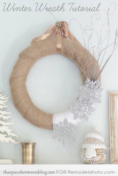 winter wreath with burlap and snowflakes made my thespacebetweenblog.net for Remodelaholic.com