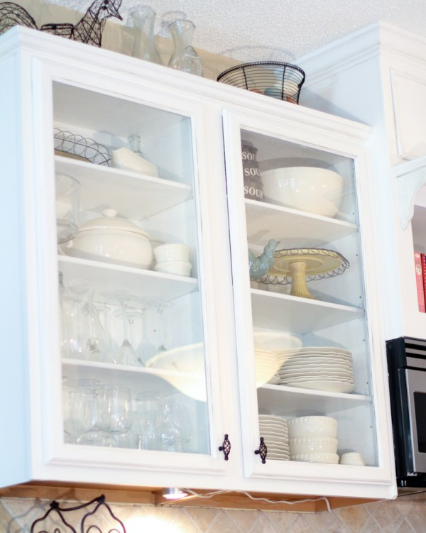 glass front cabinets, Scissors and Spatulas featured on Remodelaholic