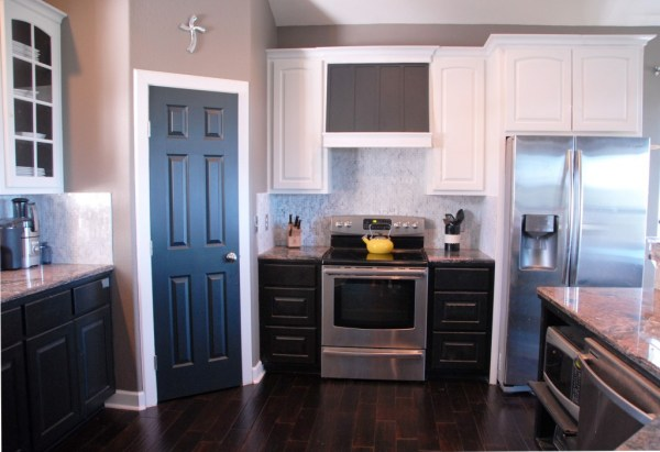 kitchen after painted cabinets and custom range hood, The Rozy Home featured on Remodelaholic