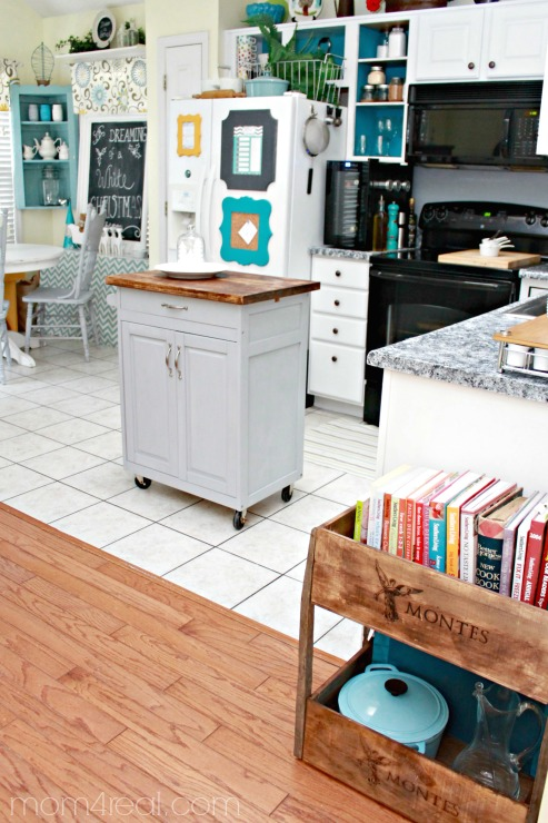 use wine crates to make a shelf for your kitchen and cookbooks, Mom4Real featured on Remodelaholic