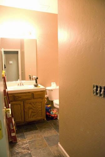 bathroom before makeover, Vintage Romance featured on Remodelaholic