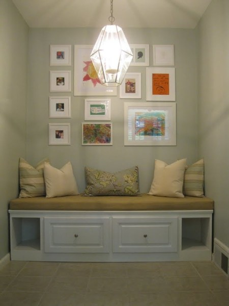 built-in banquette bench with storage and pillows, featured on Remodelaholic