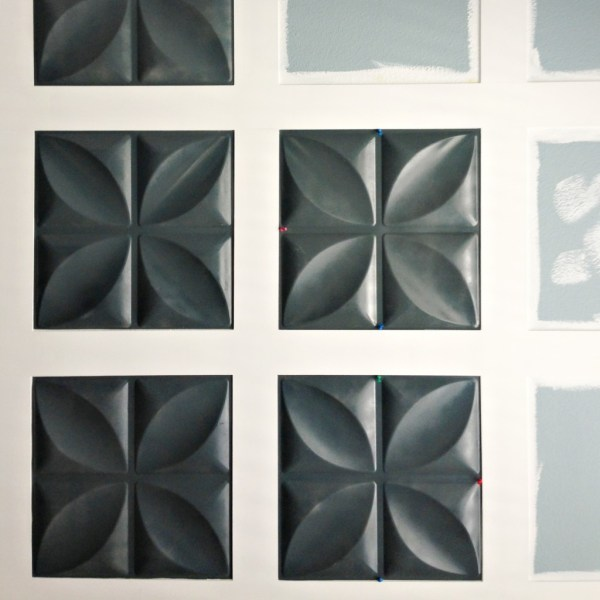 glue 3d wall panels to create a feature wall, Mesmerizing Moments featured on Remodelaholic