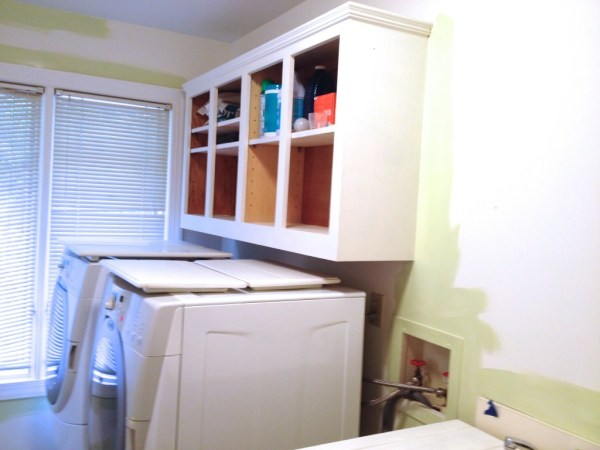 low cost laundry room makeover in soothing aloe green, featured on Remodelaholic
