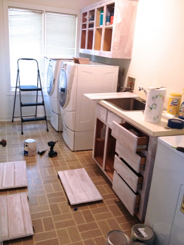 low cost laundry room makeover with painted cabinets, featured on Remodelaholic