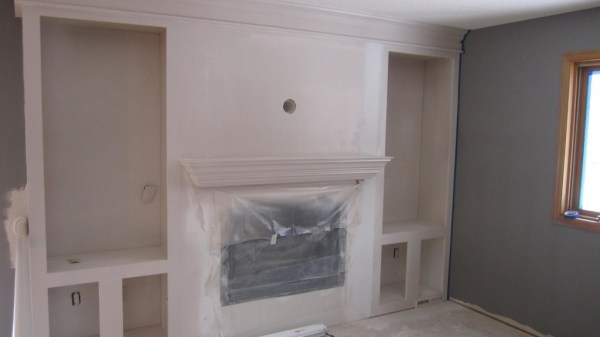 spray painted fireplace makeover, construction2style on Remodelaholic