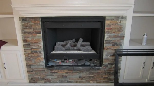 stone tile around fireplace makeover, construction2style on Remodelaholic