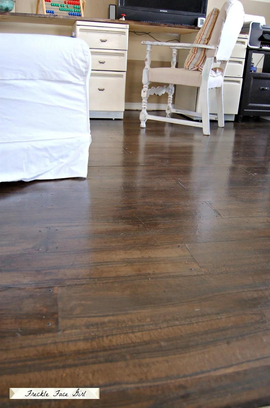 Remodelaholic | Faux Wood Plank Floors Using Brown Paper