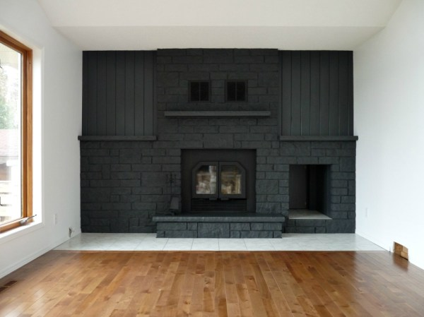 painted dark gray fireplace, Dans le Lakehouse on Remodelaholic