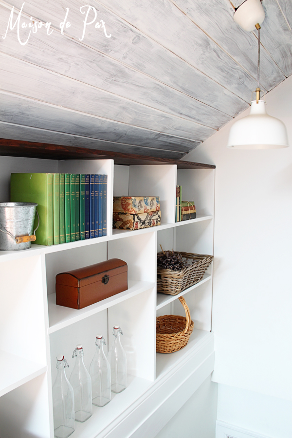 Whitewashed Attic Ceiling With Built In Shelving Along Stairs   Maison De  Pax On Remodelaholic