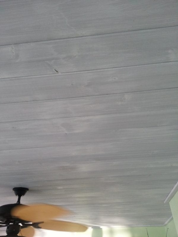 whitewashed wood over gray stained ceiling