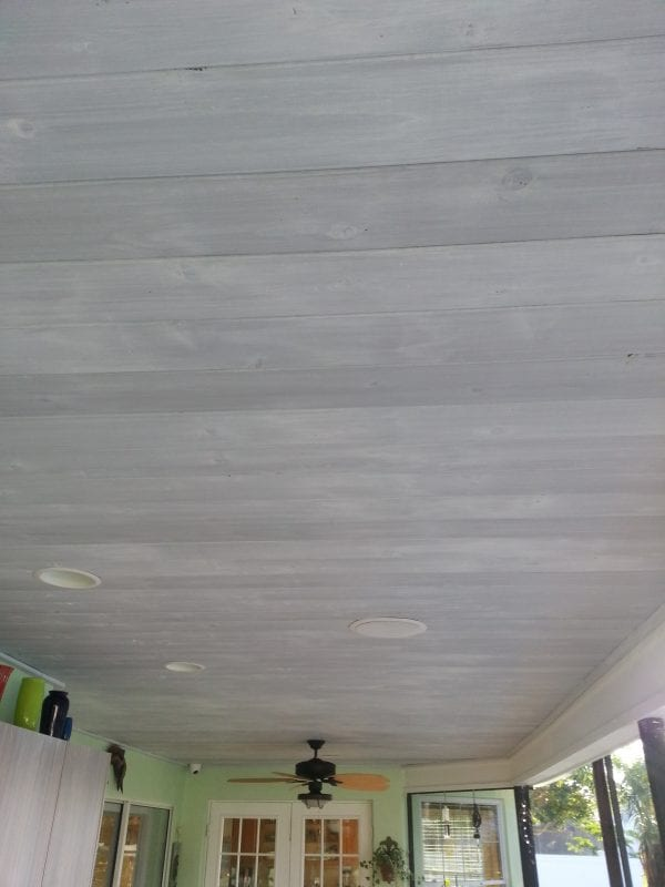 whitewashed wood ceiling over gray stain