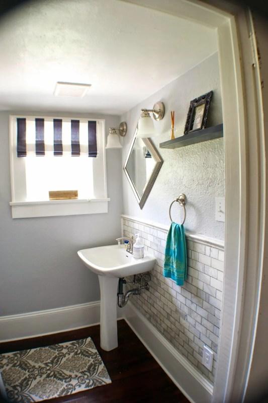 Complete Remodel! Storage Room Into Half Bath | Seesaws and Sawhorses via Remodelaholic.com #remodel #beforeandafter #marble #subwaytile