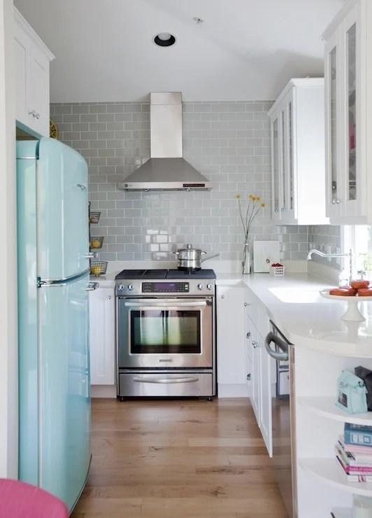 horseshoe kitchen layout with gray subway tile via DecorPad