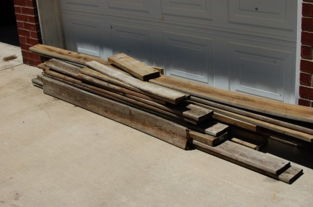 make fence posts into a rustic wood bed, The Accent Piece on Remodelaholic