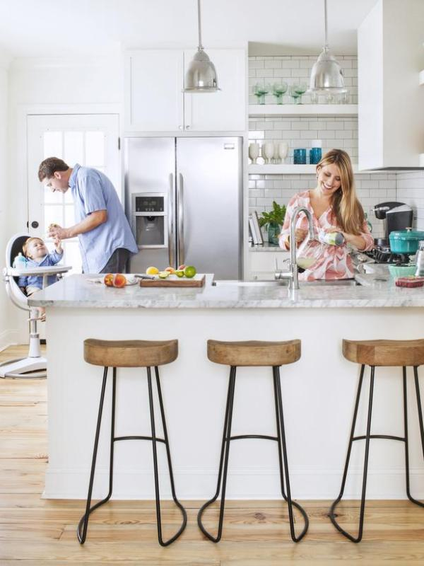 peninsula kitchen layout in white and rustic wood via HGTV