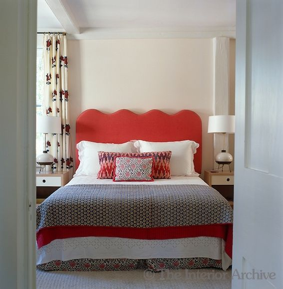 tall red curvy wave headboard via The Interior Archive