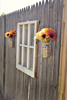Babblings and More - old window and mason jars as outdoor fence decoration - via Remodelaholic