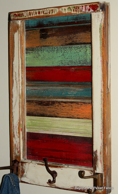 Beyond The Picket Fence - old window into wall art with wood scraps - via Remodelaholic